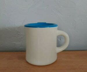 Embossed cups have an extra embossed insulating layer on the outside meaning there is no need for. Aladdin heavy-duty, double wall, white coffee mug/cup + teal blue lid | eBay