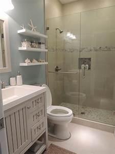 beach theme bathroom stone shower floating shelves With beachy bathroom accessories