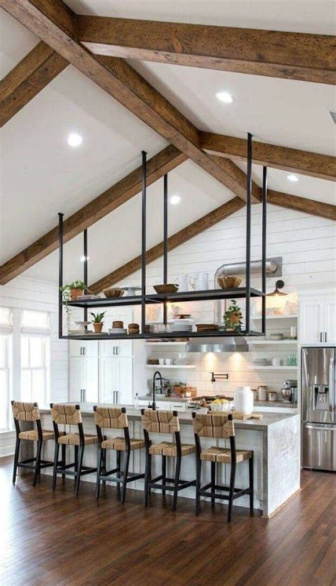 open concept kitchen  vaulted ceilings exposed beams