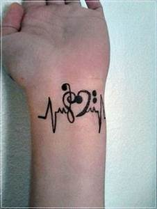 25+ Treble Clef Tattoo Images, Pictures And Photos Ideas