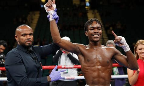 Evander Holyfield believes son Evan 'can be better than me'
