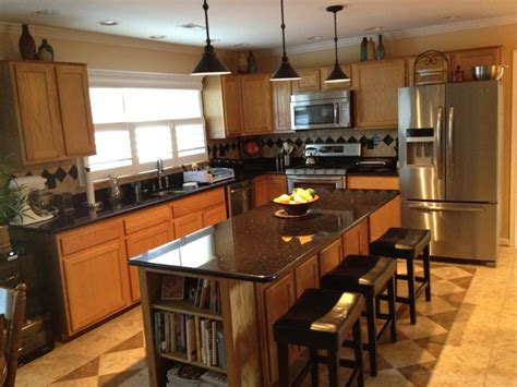 oak and black kitchen cabinets oak kitchen cabinets black counter images granite