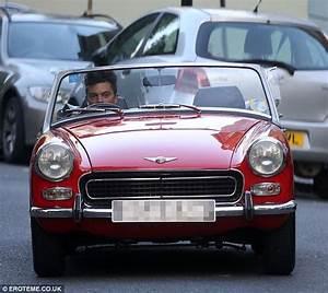 Dominic Cooper zips around in his classic convertible car ...