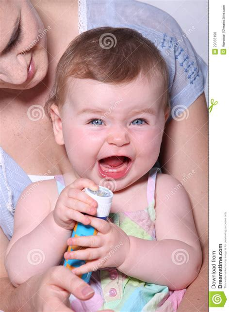 baby making  funny face stock photo image