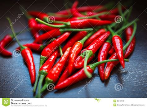 thai chilies thai red chili peppers on table stock photos image 36132673