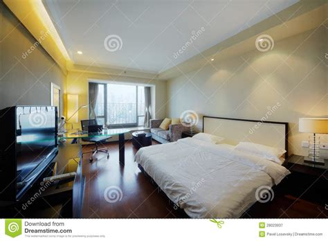 big bed in stylish light room stock image