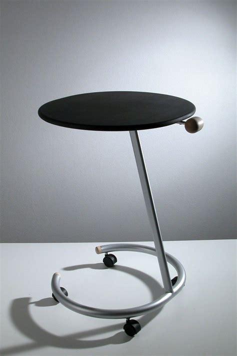 tavolino  ruote laterale divano  acciaio  legno trottolo