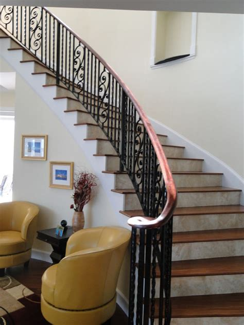 Interior wrought iron stair rail with lateral scroll