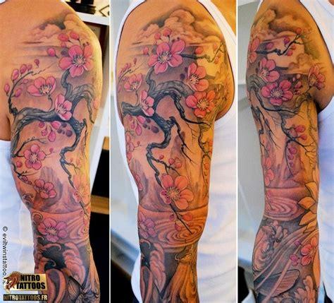 tatouage bras femme fleur de cerisier idees de tatouages