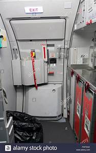 emergency exit door with kitchen in airplane Stock Photo ...
