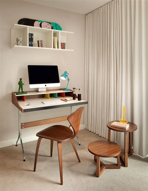 small office area with colorful working desk and wooden