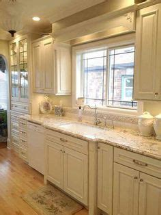 kitchen with floors these are our colors white cabs floor tile sand 6507