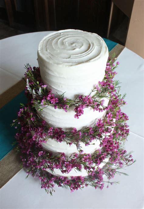 Purple Wax Flowers On Rustic Wedding Cake Wedding Ideas