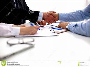 Business Meeting At Office. Handshake In Office Stock ...