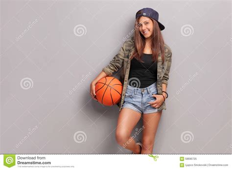 Cool Teenage Girl Holding A Basketball Stock Image Image