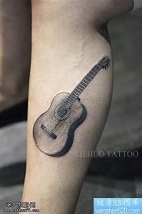 手臂吉他纹身图案