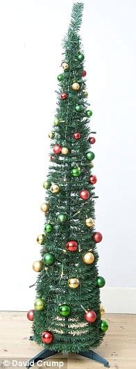 christmas trees put away that vacuum it s the year of