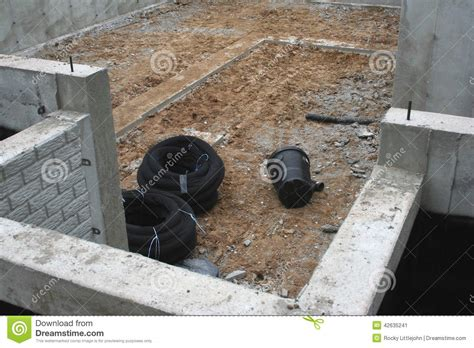 drain tile and sump housing in basement stock photo
