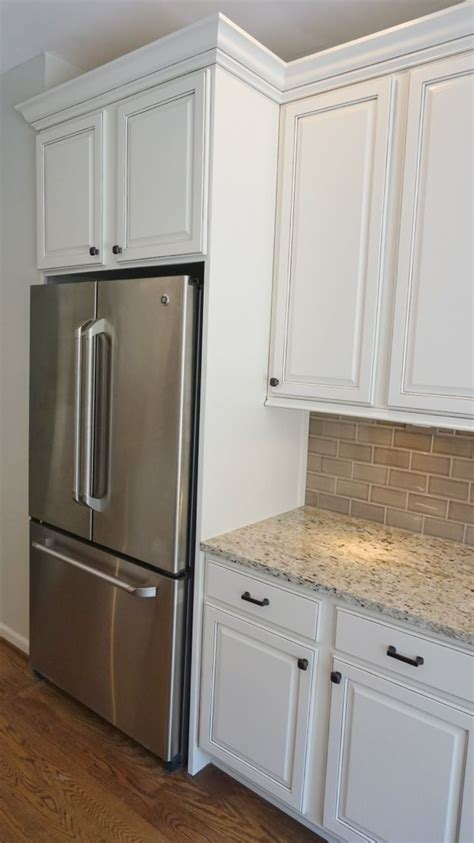 kitchen cabinets refrigerator panels refrigerator enclosure to give built in look with glazed