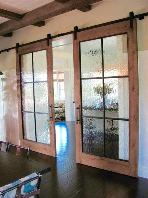 sliding barn doors with glass 15 chic glass home d 233 cor ideas shelterness