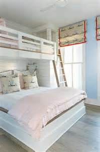 pink and blue room with bed loft bed