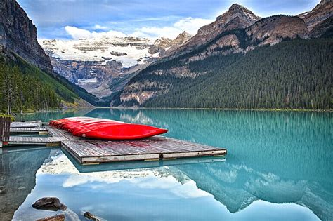 Canoes Grande Prairie by Canoes Of Lake Louise Alberta Canada Photograph By George Oze