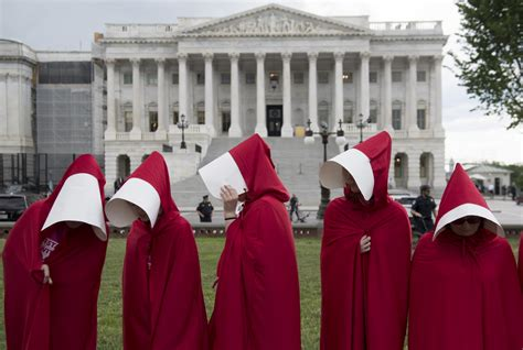 women hold handmaids tale protest  washington dc