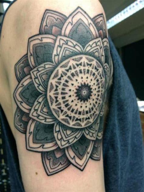 impressive geometric shoulder tattoos