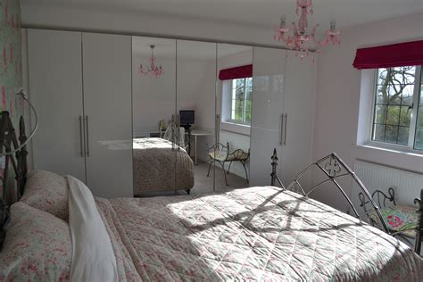 A Bedroom by Stylish Bedroom With Gloss White Cabinet And Custom Made