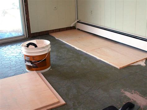 installing floor tile how to install plywood floor tiles hgtv