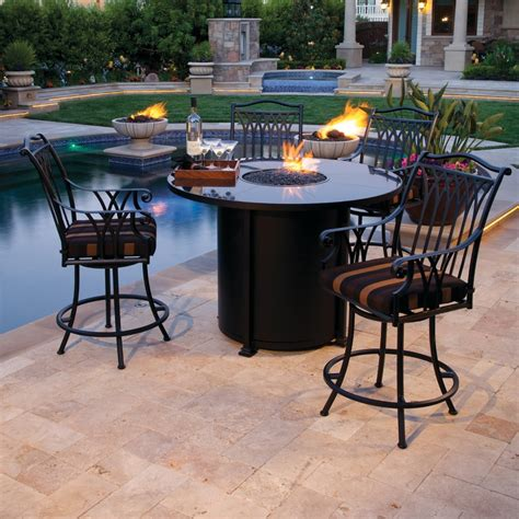 bar height patio table with pit pits reach new heights literally rich s for the