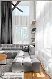 mobilier scandinave en gris blanc et bois d39un loft nordique With tapis de course avec canapé scandinave taupe