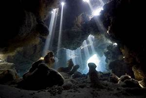 Sun Light Breaking Through Into Cave Photograph by Dray