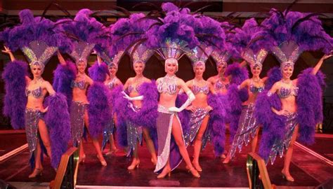 las vegas show girls purple feathers convention
