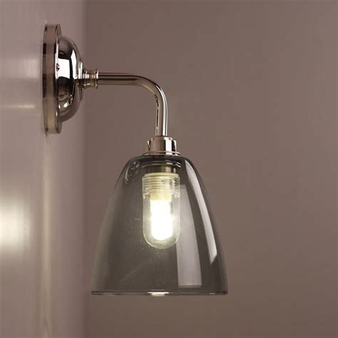 pluckley bathroom wall light with smoked glass shade