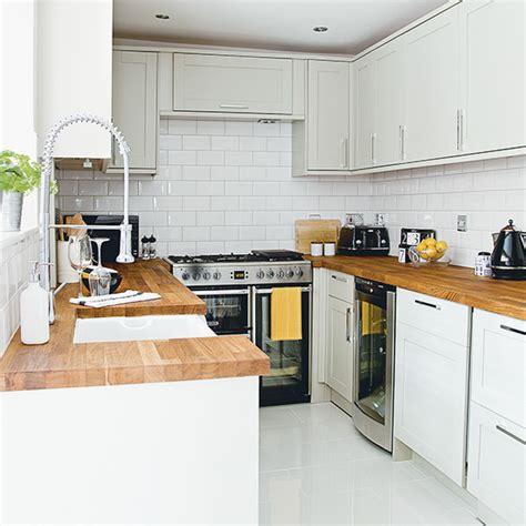 white kitchen  wooden worktops  metro tiles ideal