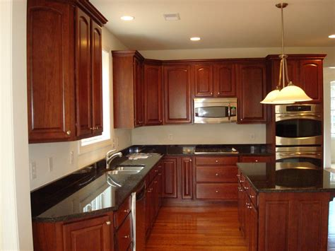 cherry wood cabinets with granite countertop simple kitchen design with black granite kitchen