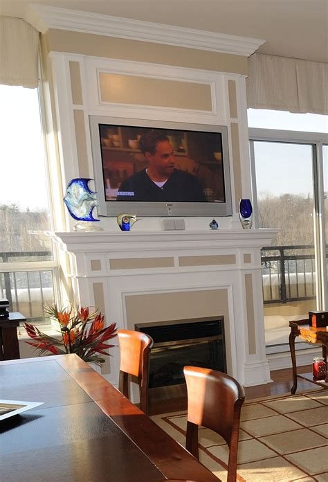 When To Mount a TV Over a Fireplace ? SPACES Custom Interiors