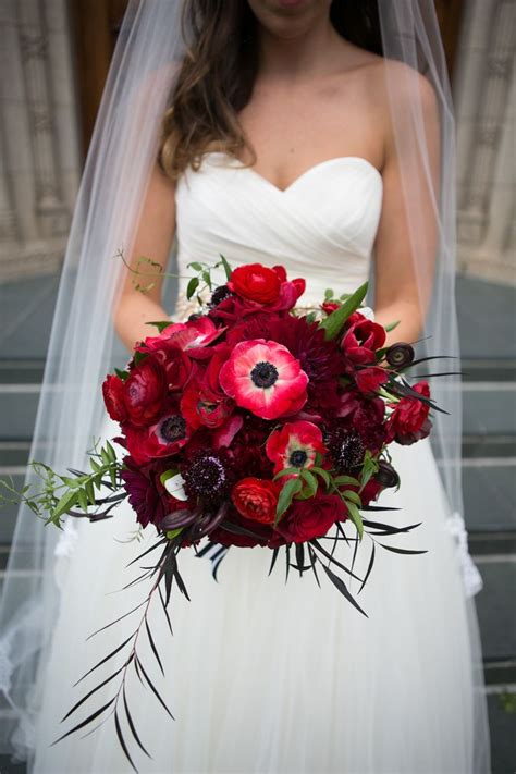 Katie Carried A Textural Red Bouquet Of Anemones