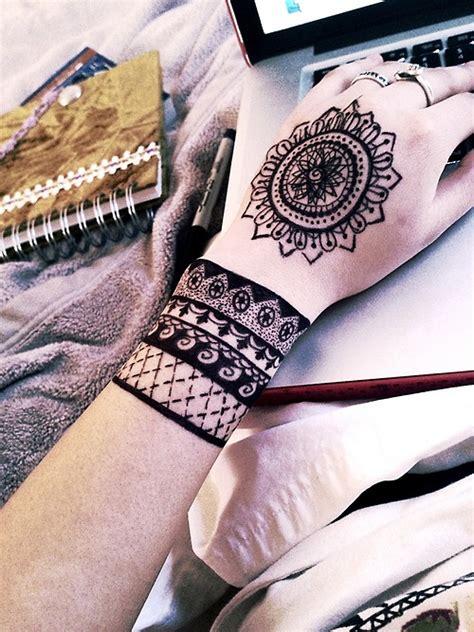 bohemian style wrist  hand tattoos tattoomagz