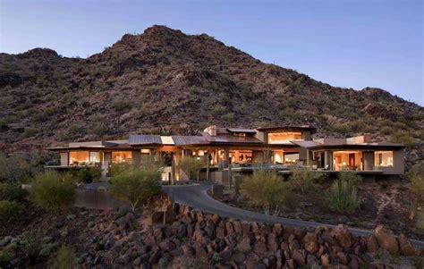 modern desert home set   rocky hillside