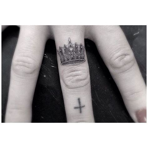 dr woo tiny detailed crown finger tattoo inked soul