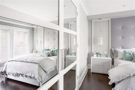 contemporary teen girls bedroom boasts mirrored closet