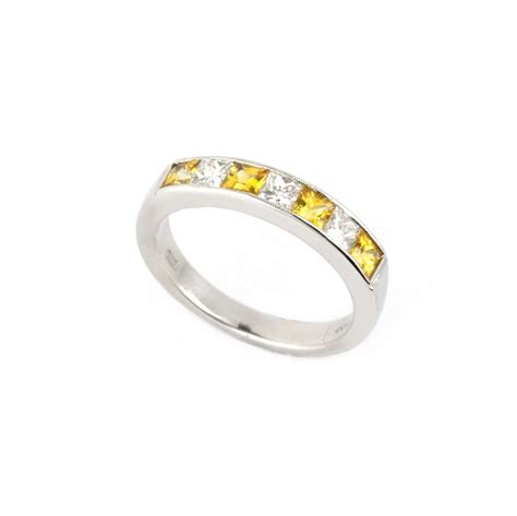 white gold yellow sapphire  diamond  eternity