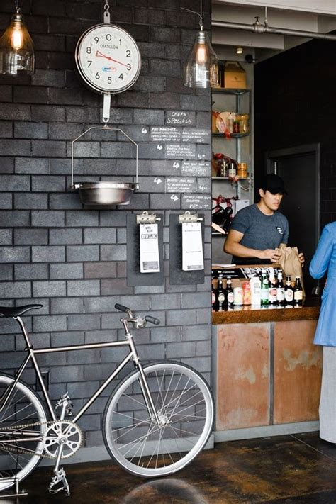 Stay At Home Bikes. Urban coffee shop style with grey stone wall great idea for street style