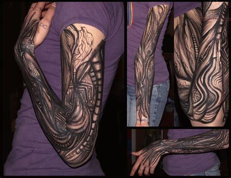 Mechanical Black Ink Tattoo On Girl Sleeve