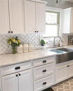 white kitchen kitchen decor subway tile herringbone With kitchen colors with white cabinets with wood sculpture wall art
