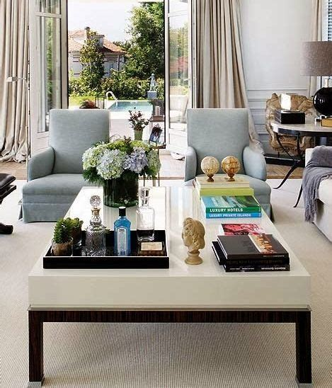 #coffeetable this coffee table has the right ingredients for styling….fresh flowers, lovely books, a tray to corral, colored glass, a gilded bowl, and a pretty box. 20 Best Coffee Table Styling Ideas - How To Decorate A Square Or Round Coffee Table