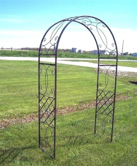 Metal Arch Trellis by Wrought Iron Fancy Curl Arbor Wedding Inspiration In