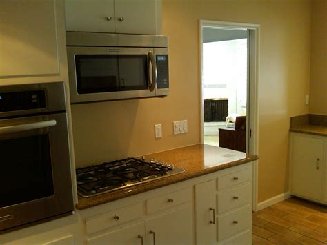 repaint kitchen cabinets repainting kitchen cabinets casual cottage